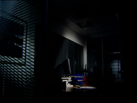 zoom in to desk in shadowy office - blinds stock videos & royalty-free footage