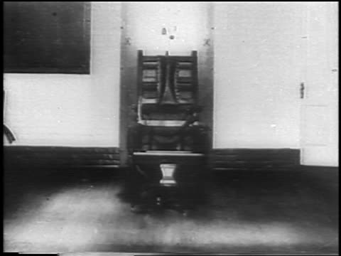 zoom in to electric chair / lap dissolve to bruno hauptmann at lindbergh kidnapping trial - electric chair stock videos & royalty-free footage