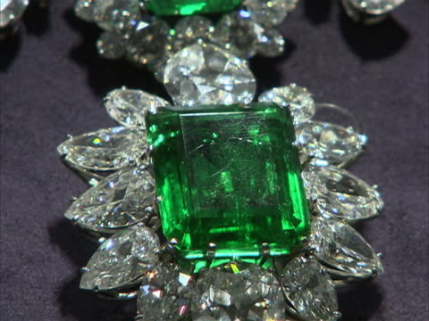 zoom in to emerald and diamond pendant owned by actor and philanthropist elizabeth taylor. these jewels were part of a four-day charity auction of... - auction stock videos & royalty-free footage