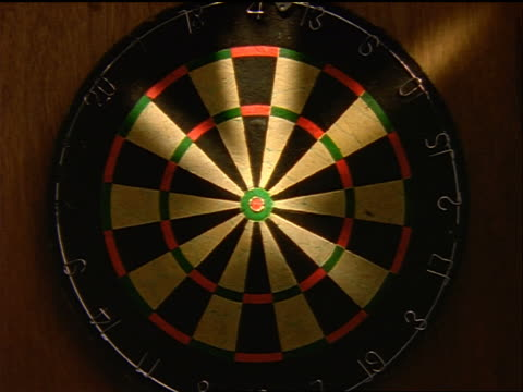 zoom in to extreme close up bullseye on dart board - dart board stock videos & royalty-free footage