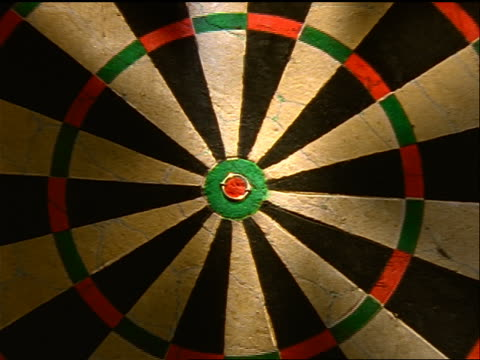 slow zoom in to extreme close up dart hitting bullseye on dart board - darts stock videos and b-roll footage