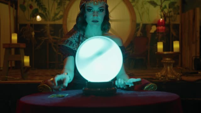 zoom in to fortune teller with crystal ball reading tarot cards in nightclub / provo, utah, united states - tarot cards stock videos & royalty-free footage