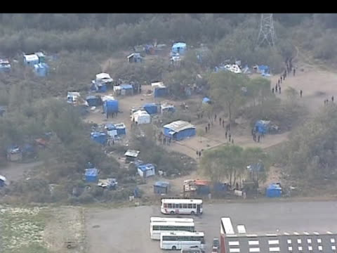 zoom in to french police officers guarding 'jungle' encampment following forceful removal of immigrants calais 22 september 2009 - calais stock videos and b-roll footage