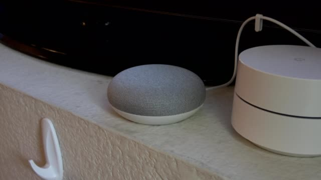 zoom in to google home mini smart speaker with google assistant in a smart home in san ramon california may 20 2019 - audio electronics stock videos and b-roll footage