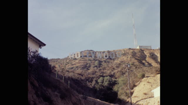 zoom in to hollywood sign against sky, hollywood, los angeles, california, usa - communications tower stock videos & royalty-free footage