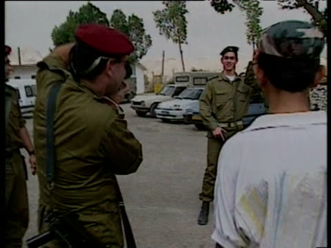 zoom in to israeli troops posing for photo april 1994 - societal symbol stock videos & royalty-free footage
