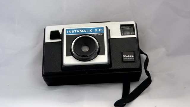 zoom in to kodak instamatic x15 vintage camera using the 126 film cartridge format ca 1970s on a white background september 6 2019 - white background stock videos & royalty-free footage
