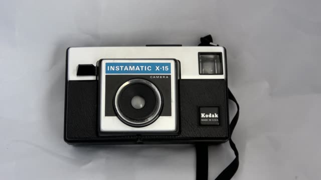 zoom in to kodak instamatic x15 vintage camera using the 126 film cartridge format ca 1970s on a white background september 10 2019 - white background stock videos & royalty-free footage