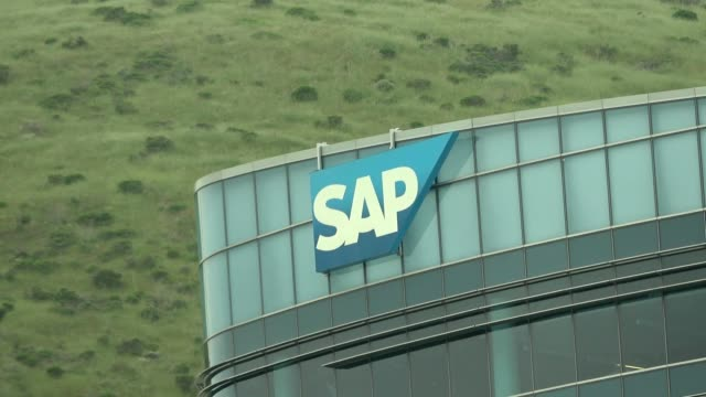 zoom in to logo for business services company sap on building in south san francisco, california, april 11, 2020. - zoom out点の映像素材/bロール