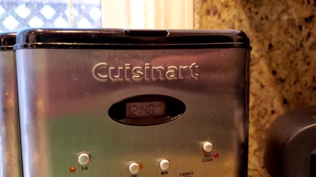 zoom in to logo for kitchen appliance company cuisinart a brand of conair corporation on a coffee maker in a domestic kitchen san ramon california... - domestic kitchen stock videos & royalty-free footage