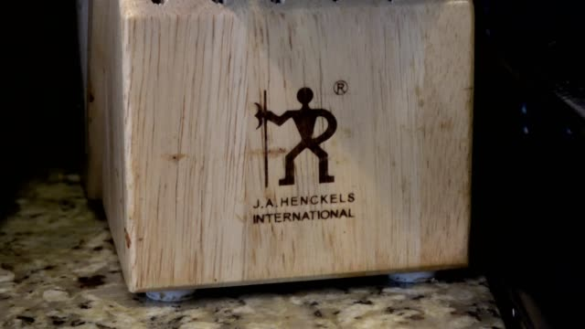 zoom in to logo for zwilling j a henckels knife company among the largest manufacturers of kitchen knives on a kitchen knife block in a domestic room... - domestic kitchen stock videos & royalty-free footage