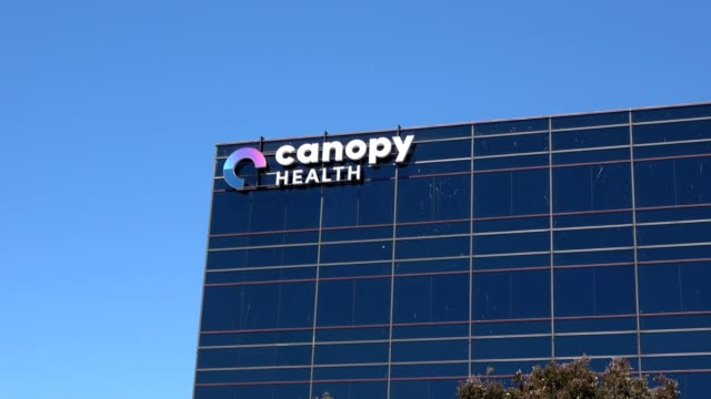 zoom in to logo on facade at office of canopy health, a healthcare company in emeryville, california, 2018. - emeryville stock videos & royalty-free footage