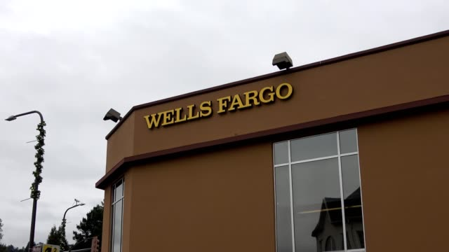 zoom in to logo on facade of branch of wells fargo bank on solano avenue in berkeley california january 8 2019 - wells fargo stock videos and b-roll footage