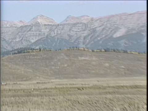zoom in to peaks of gros-ventre-range from across prairie - prairie stock videos & royalty-free footage