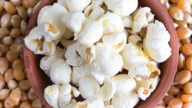 Zoom in to popcorn kernels: popped ones in the centre contrasted with non popped ones outside