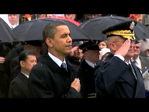 stockvideo's en b-roll-footage met zoom in to president barack obama standing with his hand across his chest as american national anthem is played during memorial ceremony marking on... - virginia amerikaanse staat