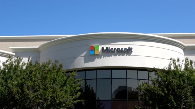 zoom in to sign with logo for computer company microsoft at regional office in the silicon valley mountain view california may 3 2019 - logo stock-videos und b-roll-filmmaterial
