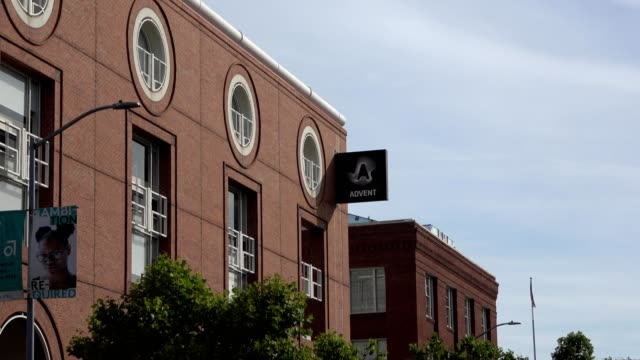 zoom in to sign with logo on facade at office of software company advent in the south of market neighborhood of san francisco california june 10 2019 - advent stock videos & royalty-free footage