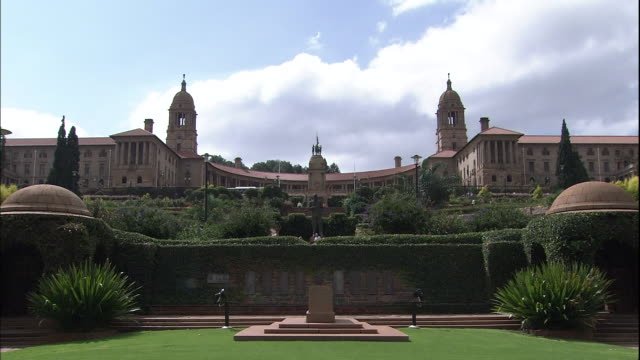 Zoom in to South African flag atop tower on Union Buildings, Pretoria