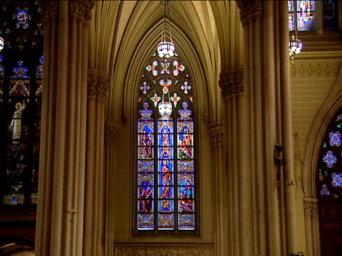 zoom in to stained glass window in st patrick's cathedral - st. patrick's cathedral manhattan stock videos and b-roll footage