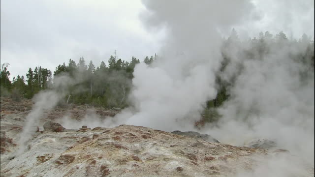 zoom in to steam rising from steamboat geyser - geyser stock videos and b-roll footage