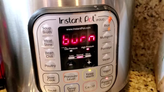 zoom in to text reading burn on screen on instantpot cooking appliance, a common occurrence when cooking with the device, san ramon, california,... - occurrence stock videos & royalty-free footage
