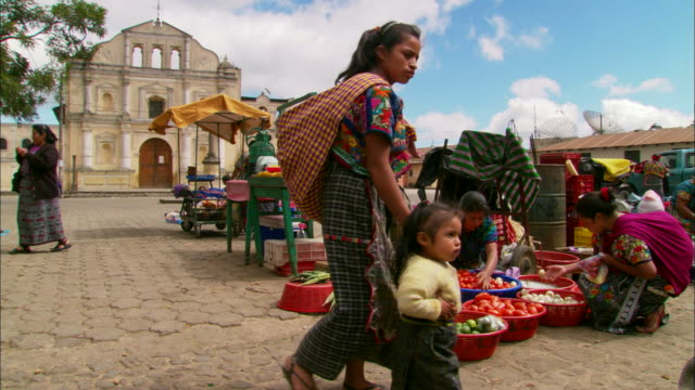 zoom in to woman selling fruit at street market available in hd. - guatemala stock videos & royalty-free footage