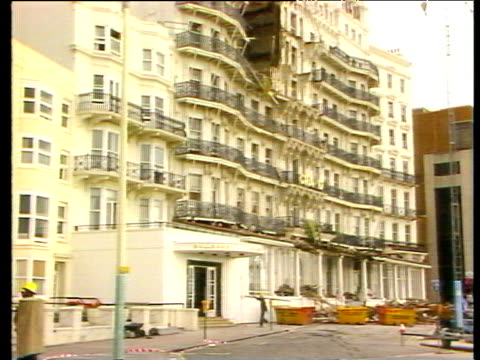 zoom in to wrecked facade of hotel after ira bomb explosion brighton bomb; 13 oct 84 - bomb stock videos and b-roll footage