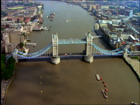 AERIAL zoom in Tower Bridge with traffic + River Thames in London