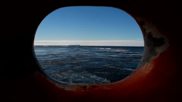 Zoom in view through port hole, Antarctica