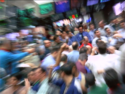 zoom in + zoom out time lapse crowd of male traders shouting + waving arms below displays / commodity exchange, nyc - 1999 stock videos & royalty-free footage