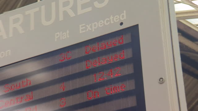 Zoom into a departures board showing cancelled trains at Preston railway station during a train strike