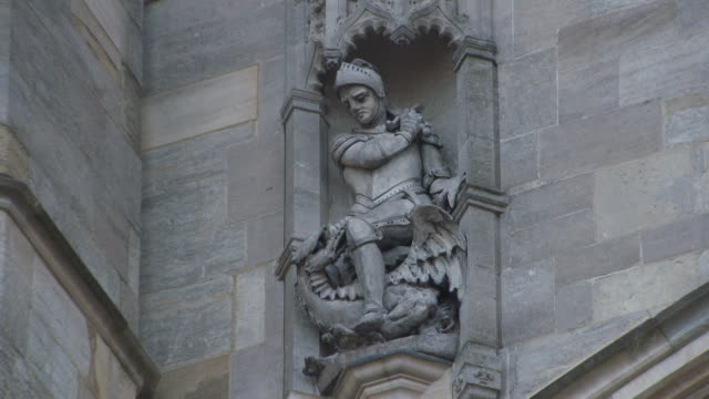 Zoom into a rendering in stone of St George slaying the dragon at St George's Chapel part of Windsor Castle UK FKAU104L Clip taken from programme...