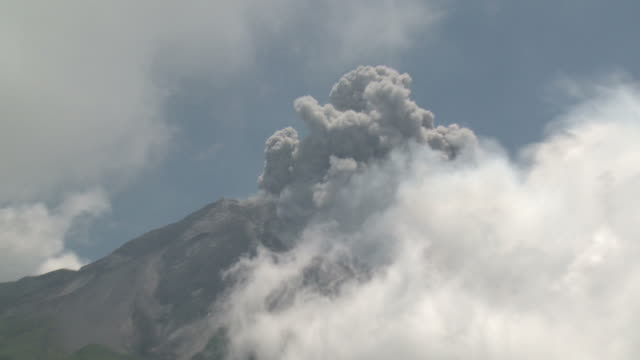 Zoom into eruption of ash from top of Merapi volcano; Central Java, Indonesia. 29 October 2010