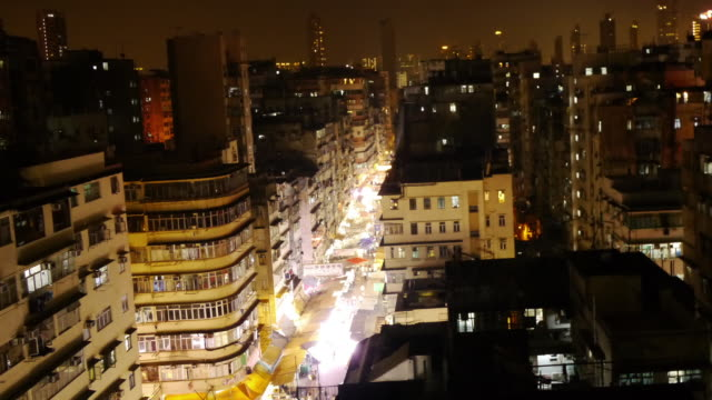 tl zoom into illuminated night market sham shui po, hong kong. - heranzoomen stock-videos und b-roll-filmmaterial