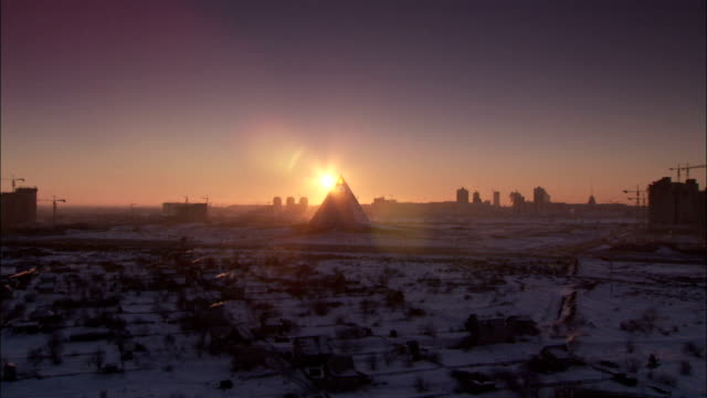 zoom into pyramid of peace at sunset. \n available in hd. - kazakhstan stock videos and b-roll footage