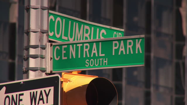 zoom into the central park south at columbus circle street signs. - columbus circle stock videos & royalty-free footage