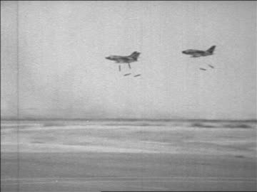 zoom out 3 bombers dropping bombs over desert in six day war / newsreel - 1967 stock videos & royalty-free footage