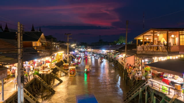 zoom out: 4k day to night timelapse at amphawa floating market in sunset ,samut songkhram,thailand - sequential series stock videos & royalty-free footage