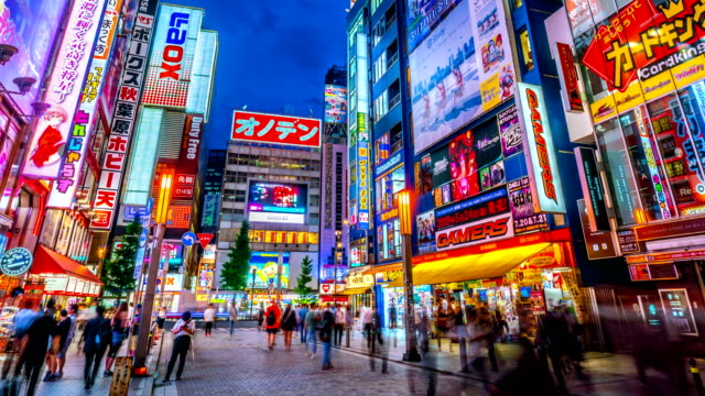 zoom out 4k time lapse akihabara at twilight, tokyo japan. - akihabara stock videos and b-roll footage