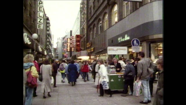 zoom out along busy shopping street in hanover - walkable city stock videos & royalty-free footage