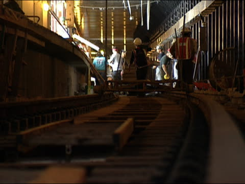 zoom out along subway tracks in station at world trade center construction site / new york city - september 11 2001 attacks stock videos and b-roll footage