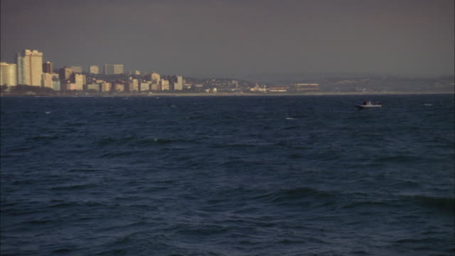 zoom out and pan across durban coastline. available in hd. - durban stock videos & royalty-free footage