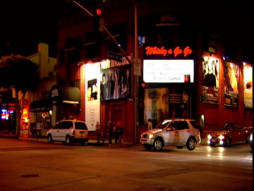 zoom out and pan left from whisky a go go club to crossroad on sunset strip - sunset boulevard los angeles stock videos & royalty-free footage