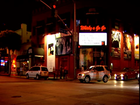 Zoom out and pan left from Whisky a Go Go club to crossroad on Sunset Strip
