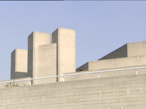 zoom out and pan right across concrete exterior of national theatre - concrete stock videos & royalty-free footage