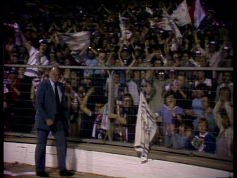 Zoom out and pan right as England manager Ron Greenwood walks past jubilant supporters after 31 victory over Argentina Wembley Stadium 13 May 80
