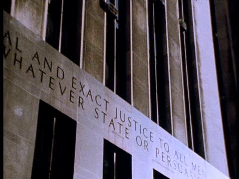 stockvideo's en b-roll-footage met zoom out and tilt up district attorney's office; 1970s - aanklager rechtszaak