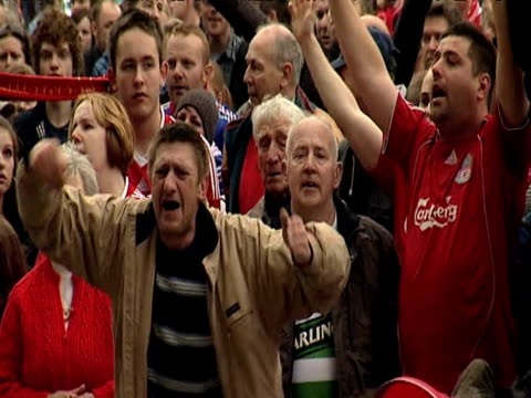 zoom out as large group of nottingham forest fans clap cheer and sing during memorial service marking 20th anniversary of hillsborough tragedy; 15... - swaying stock videos & royalty-free footage