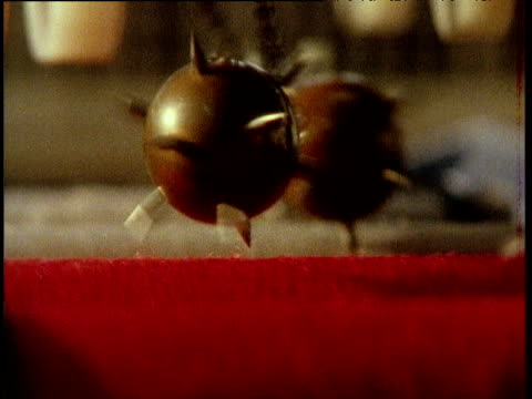 zoom out as spiked balls bounce over fabrics during quality control testing in textiles factory london 1970's - spiked stock videos & royalty-free footage